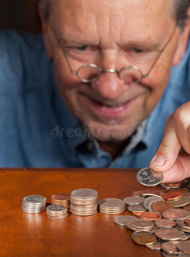 Download Senior Man Counting Cash Into Piles Stock Photo - Image: 25622526