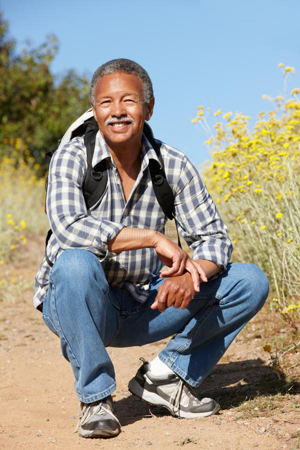 Download Senior man on country hike stock photo. Image of countryside - 25430340