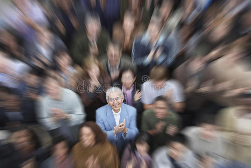 Senior Man With Crowd Applauding stock photo