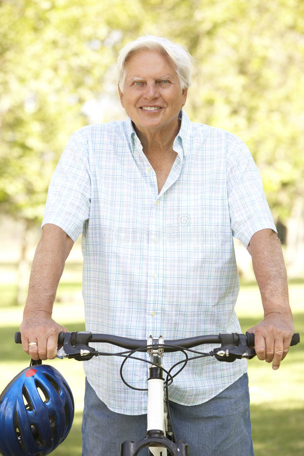 Senior Man On Cycle Ride In Park royalty free stock image