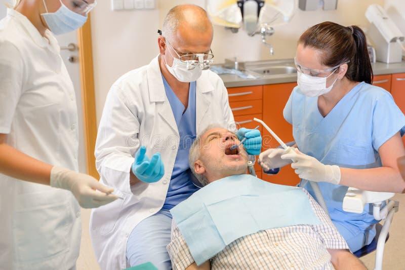 Senior man at dentist surgery have operation stock photos