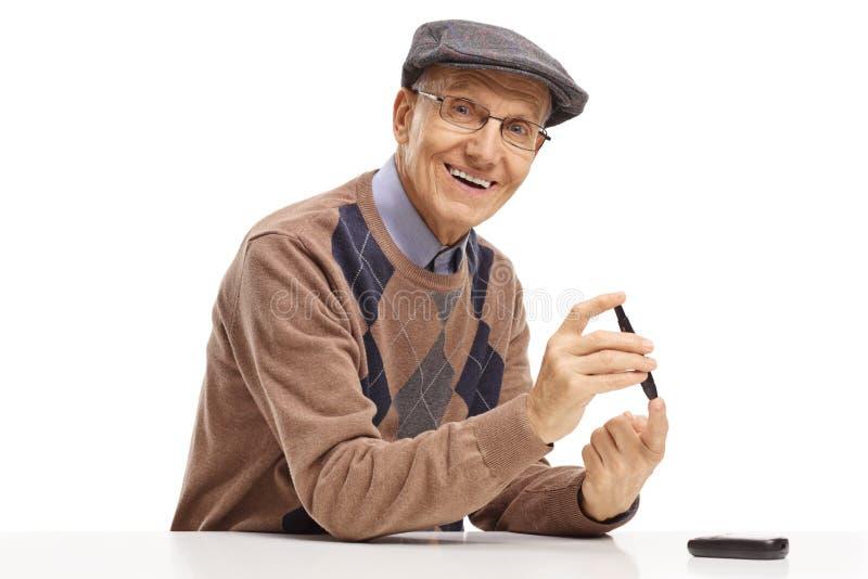 Senior man with a diabetes measuring device stock photo