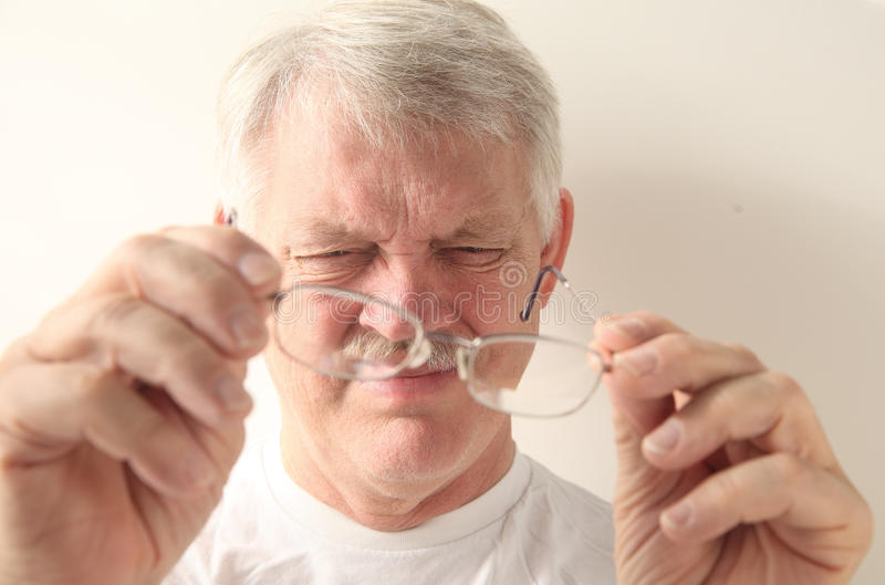 Download Senior Man With Dirty Glasses Royalty Free Stock Photography - Image: 26178427