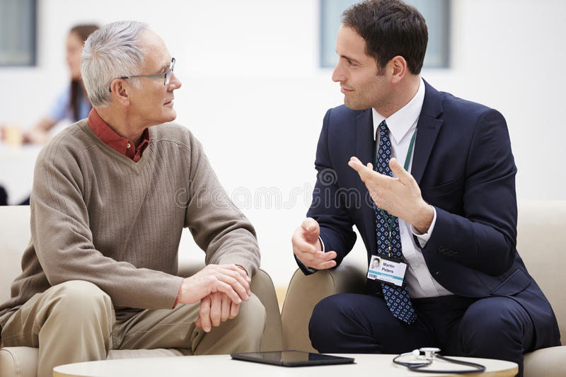 Senior Man Discussing Test Results With Doctor royalty free stock image