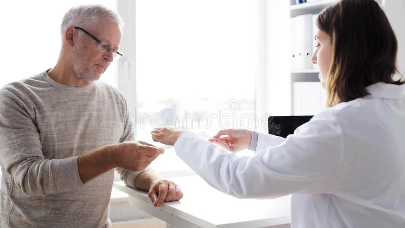 Senior man and doctor meeting at hospital 58. Medicine, age, health care and people concept - senior man and doctor meeting in medical office at hospital stock video footage