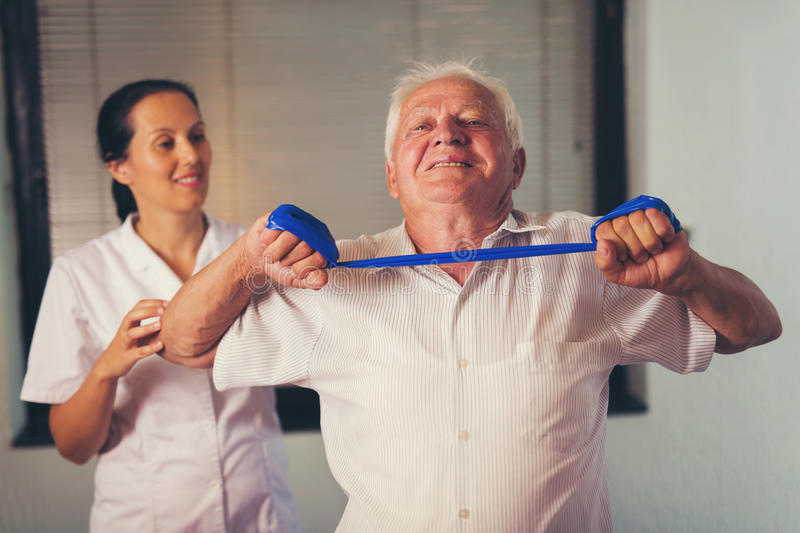 Senior man doing exercises using a strap stock image