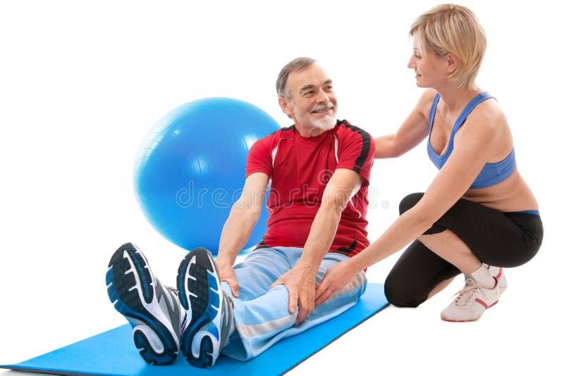 Senior man doing fitness exercise stock photo