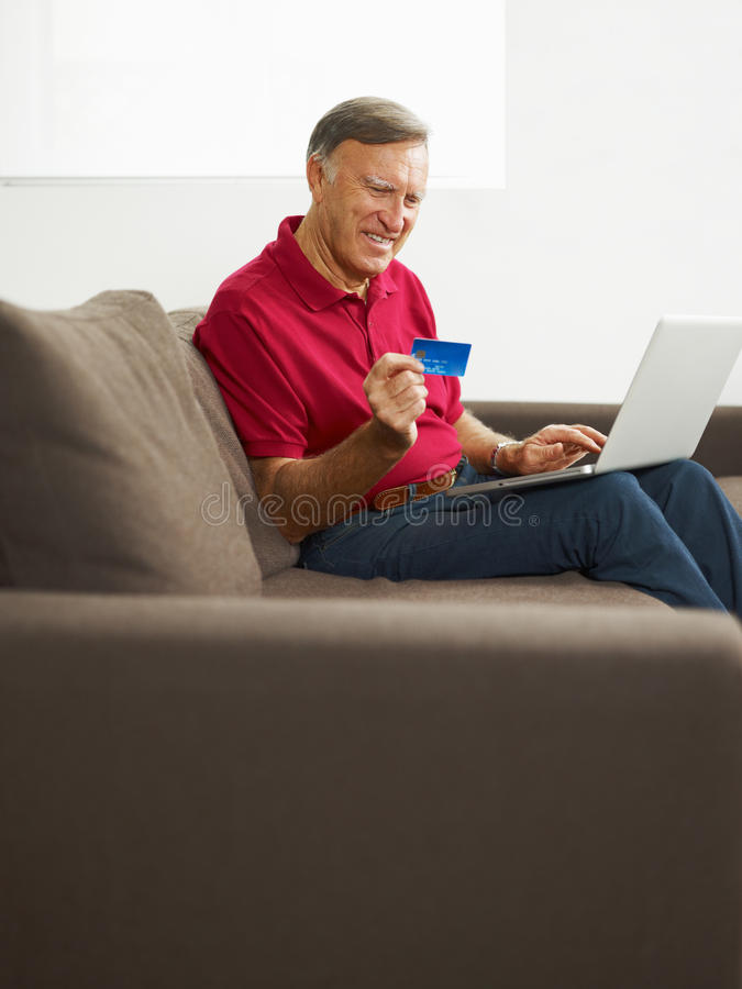 Senior man doing online shopping stock photography