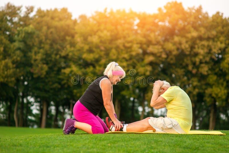 Senior man doing physical exercise. stock image
