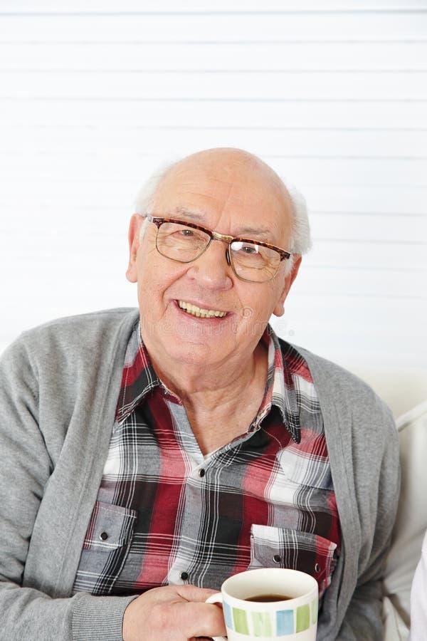 Senior man drinking cup of coffee stock photo