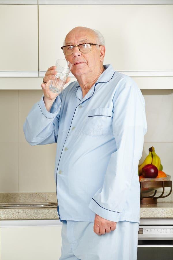 Senior man drinking water royalty free stock image