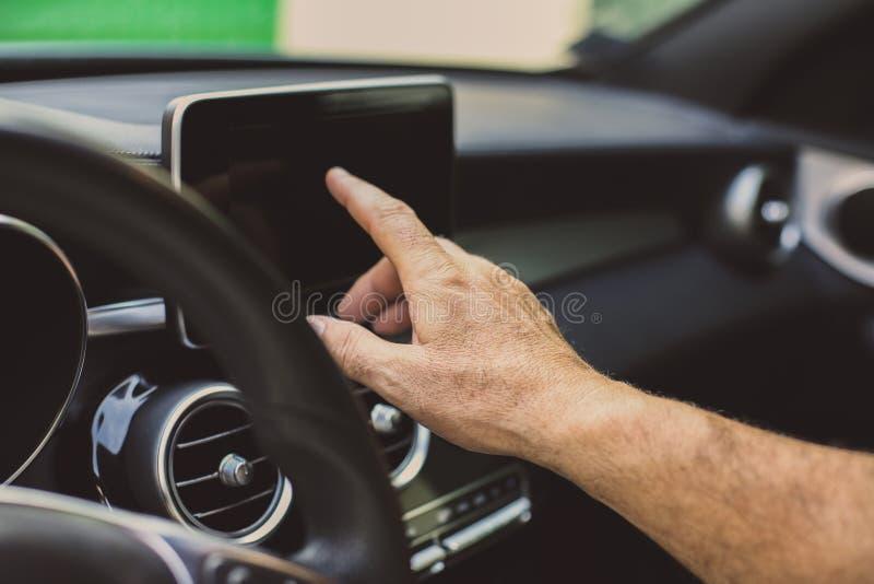 Senior man driving car and using navigation. Senior man in car. Senior man driving car and using navigation. Close up stock image