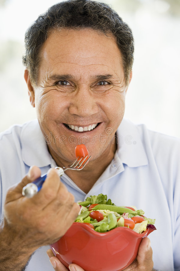 Senior Man Eating A Fresh Green Salad stock photos