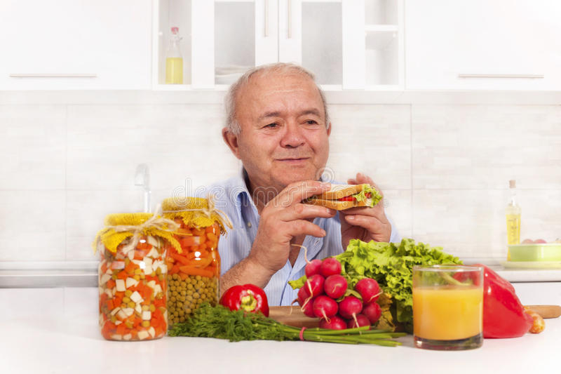 senior man eating healthy diet stock photo