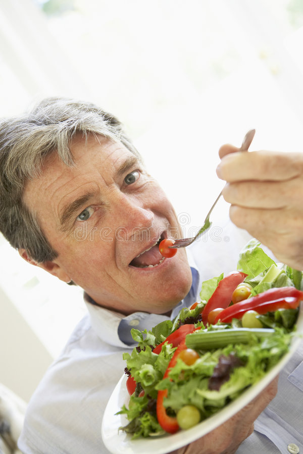 Senior Man Eating Salad royalty free stock image