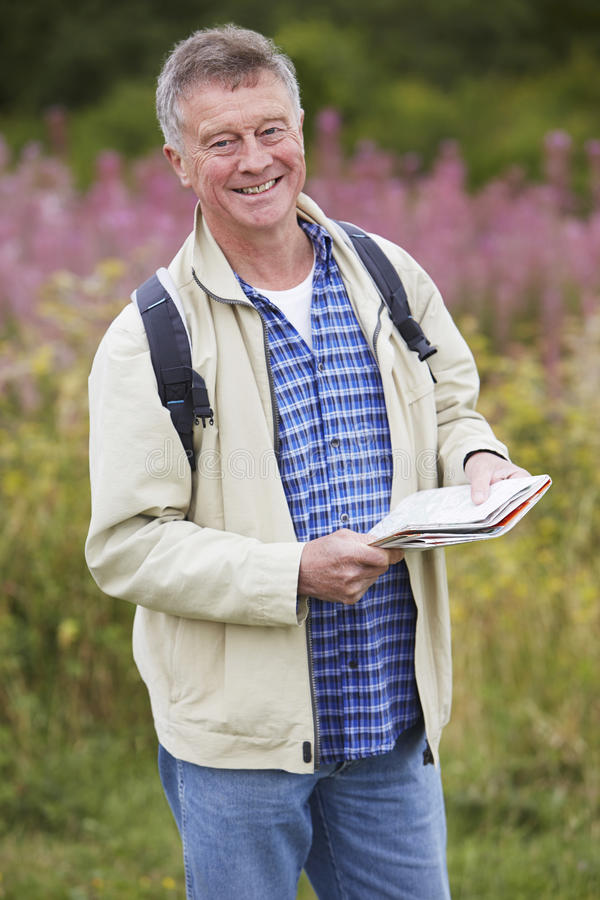 Senior Man Enjoying Hike In The Countryside. Senior Man Walks In Countryside stock image