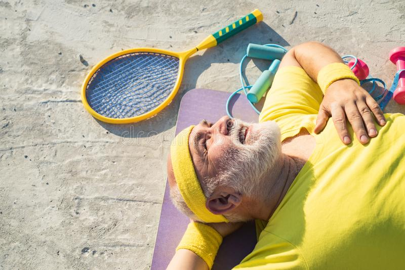 Senior man exercising on blue sky. Senior sportsman in sport center. Healthcare cheerful lifestyle. Sporting. Senior man exercising on blue sky. Senior royalty free stock image