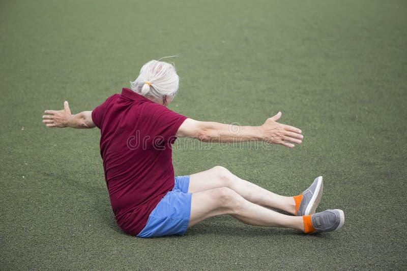 Senior man exercising in an open stadium stock photos