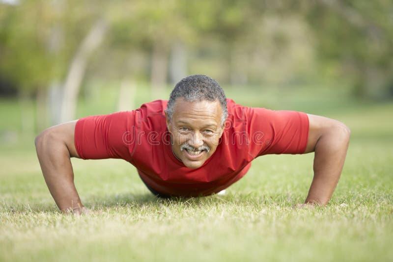 Senior Man Exercising In Park royalty free stock photography