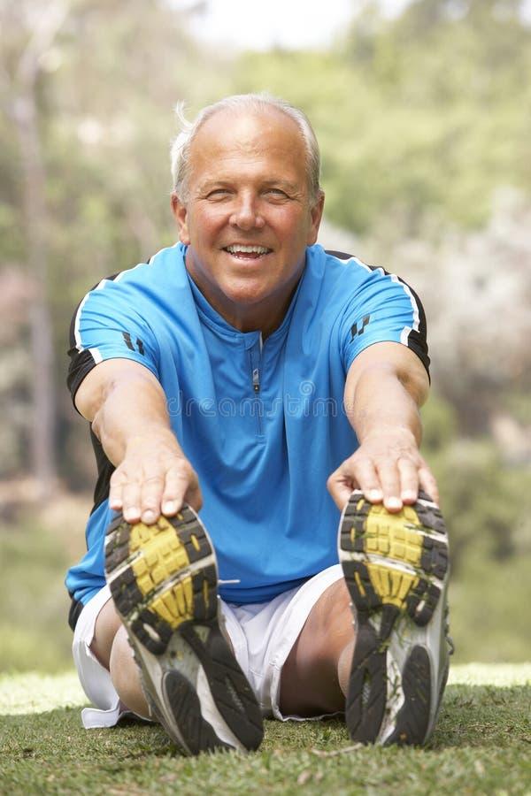 Senior Man Exercising In Park royalty free stock images