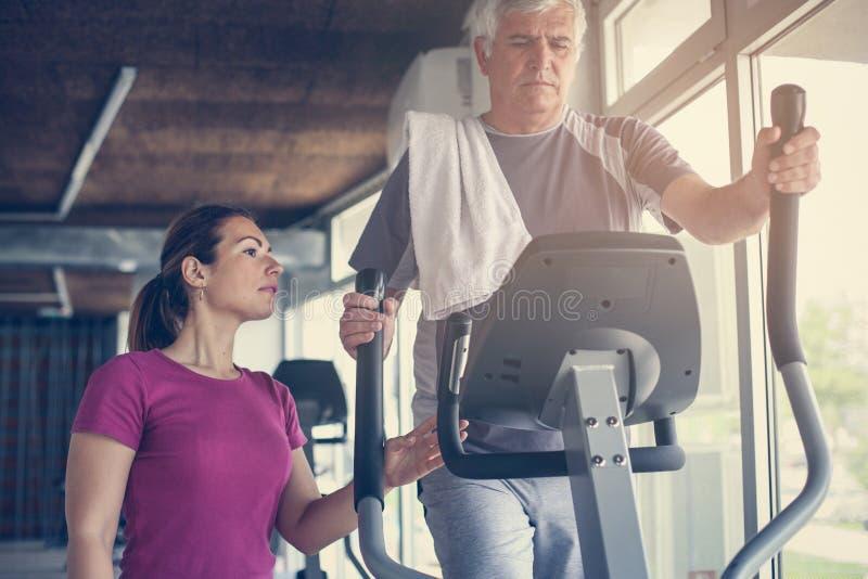 Download Senior Man Exercising On Stationary Bikes. Stock Image - Image of health, elliptical: 98369047