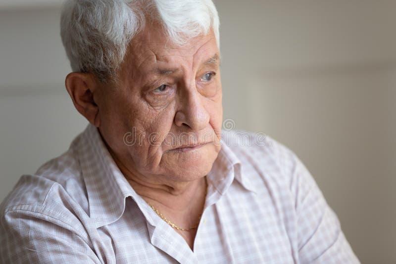 Senior man feels sad and lonely close up portrait stock photos
