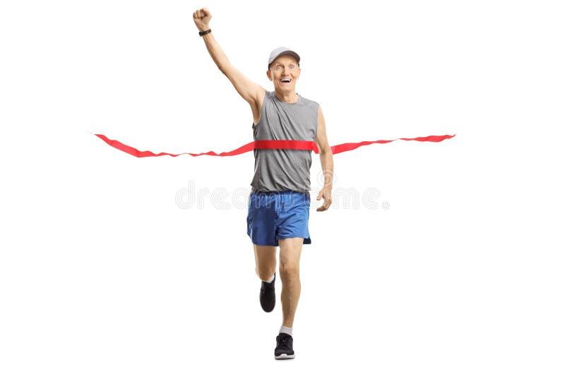 Senior man on the finish of a marathon gesturing happiness stock image