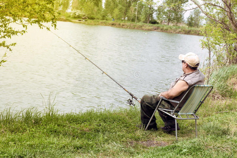 Senior man fishing stock images