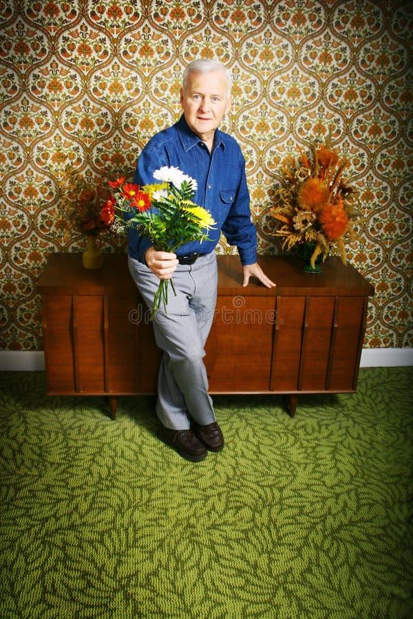 Senior man with flowers royalty free stock photo