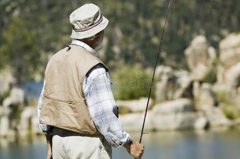 Download Senior man fly fishing stock photo. Image of person, active - 13584722