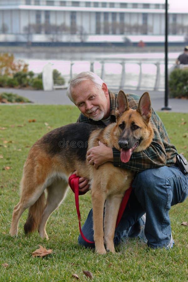 Senior Man and German Sheperd Dog stock photos