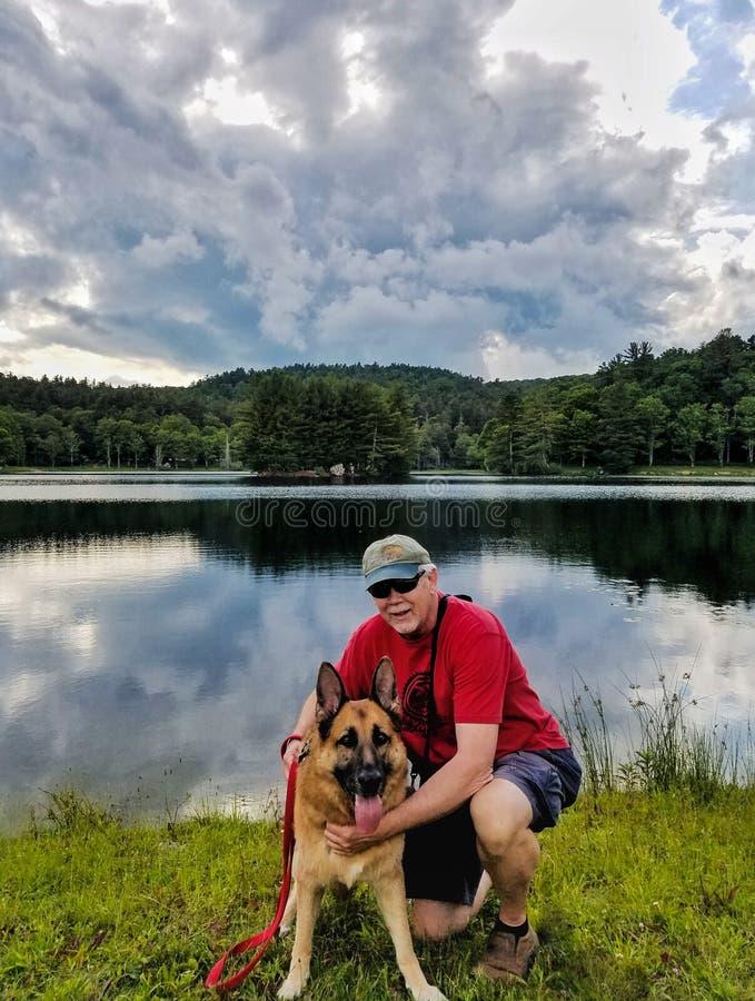 Senior Man with German Shepherd Dog royalty free stock photos