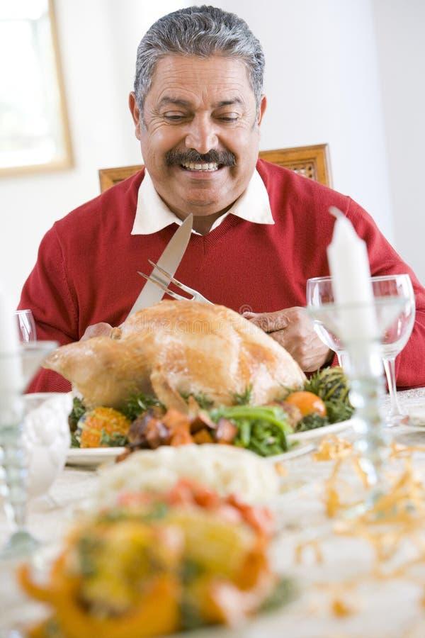 Senior Man Getting Ready To Carve The Turkey