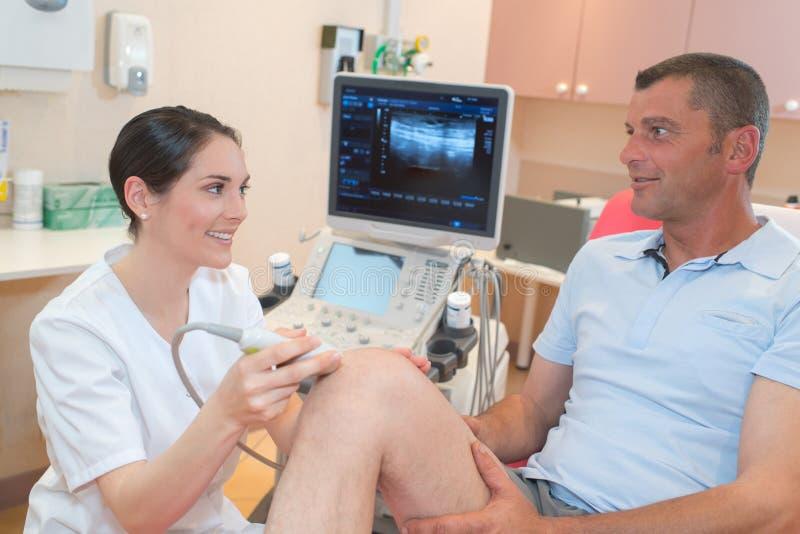 Senior man getting ultrasound scan on knee. Senior men getting ultrasound scan on knee medical royalty free stock photos