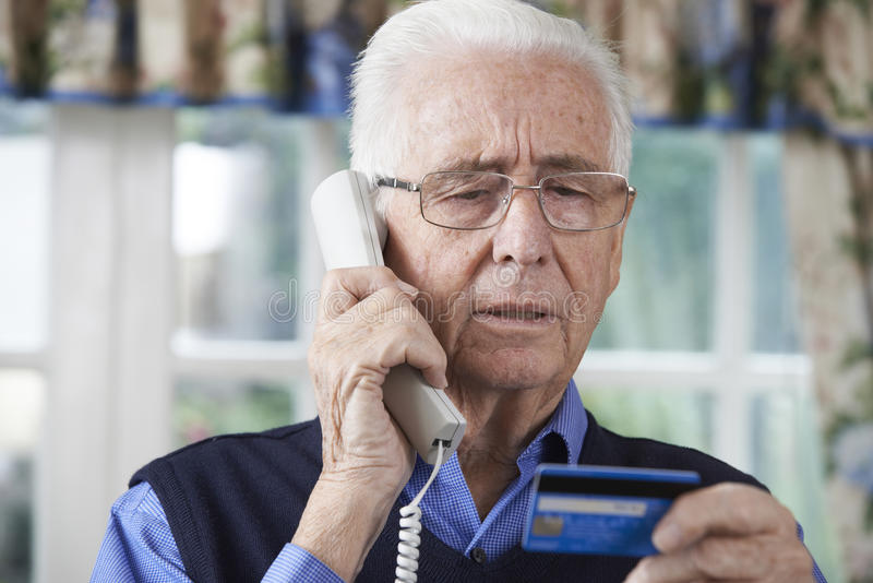 Download Senior Man Giving Credit Card Details On The Phone Stock Photo - Image of scam, security: 60171428