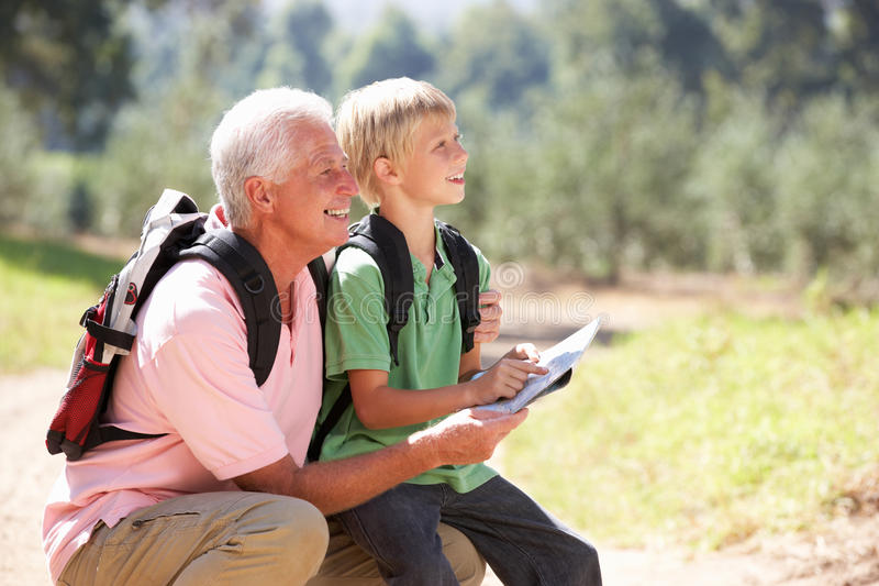 Senior man with grandson on country walk royalty free stock photography