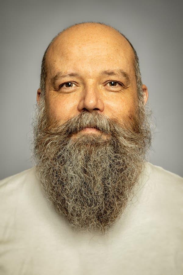 Senior man with a gray long beard royalty free stock images