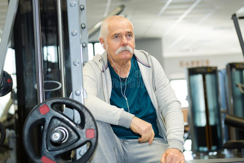 Senior man in gym working out royalty free stock photo