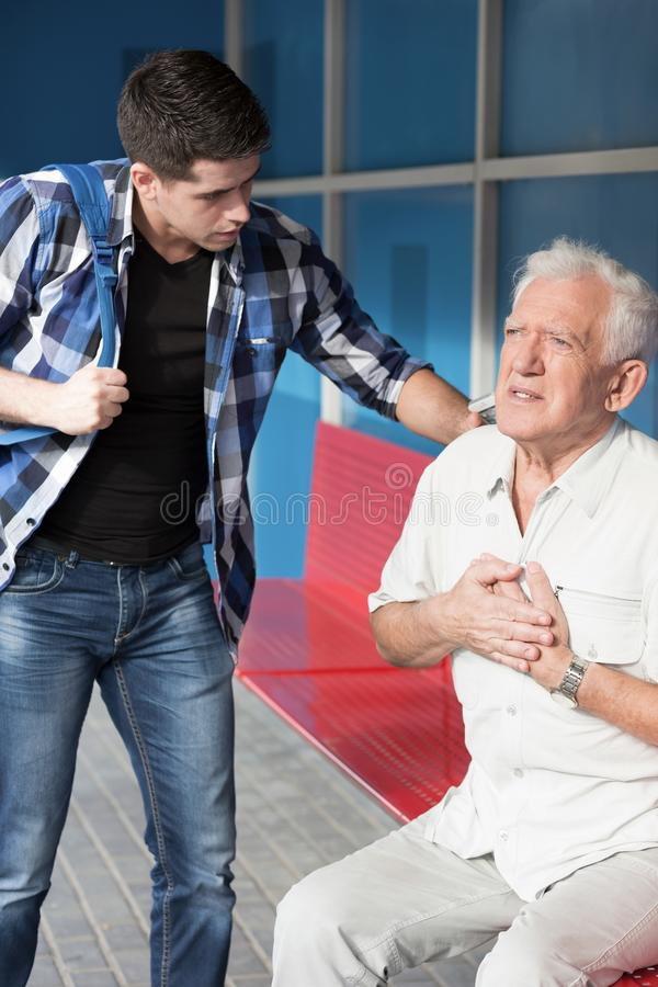 Senior man having heart infarct stock photo