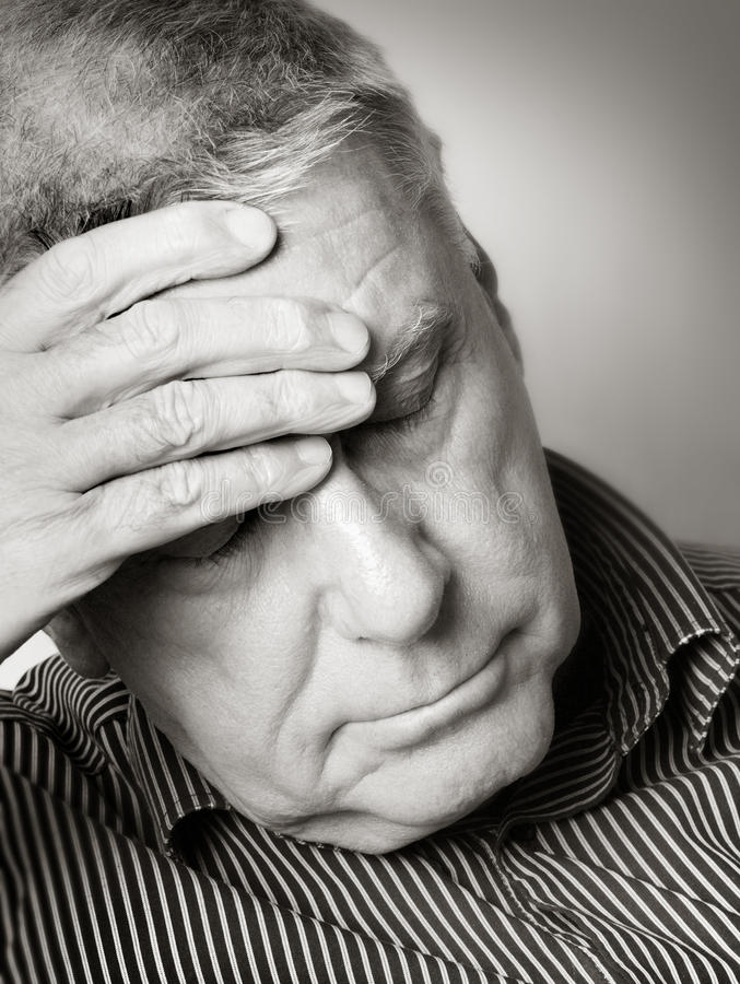 Senior man with a headache royalty free stock photography
