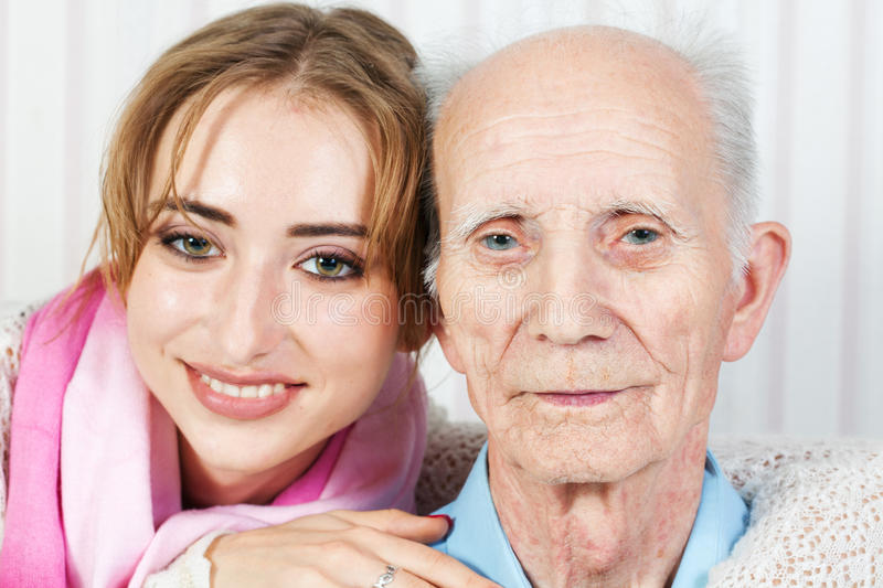 Senior man with her caregiver. Senior men with her caregiver at home royalty free stock photography