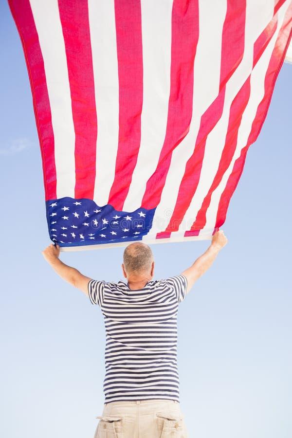 Senior man holding american flag stock photography