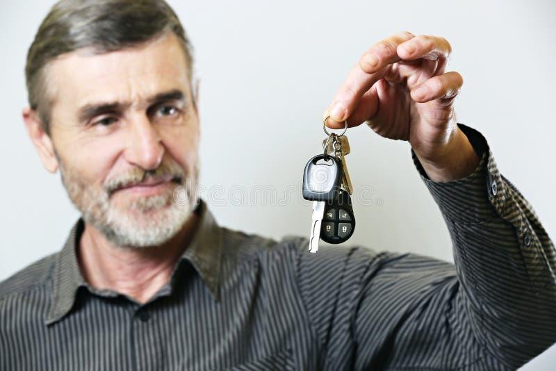 Senior man holding car key stock photos