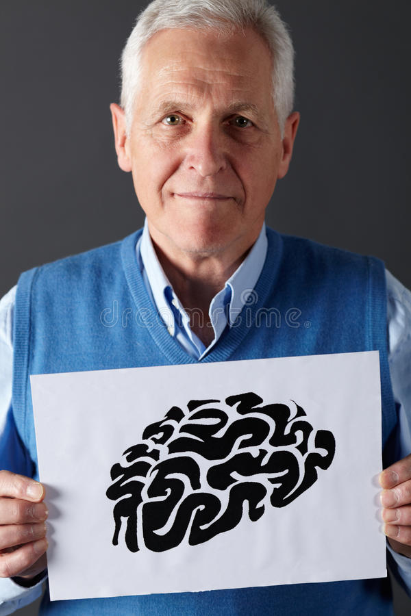 Senior man holding ink drawing of brain. Close up portrait of senior man holding ink drawing of brain stock photography