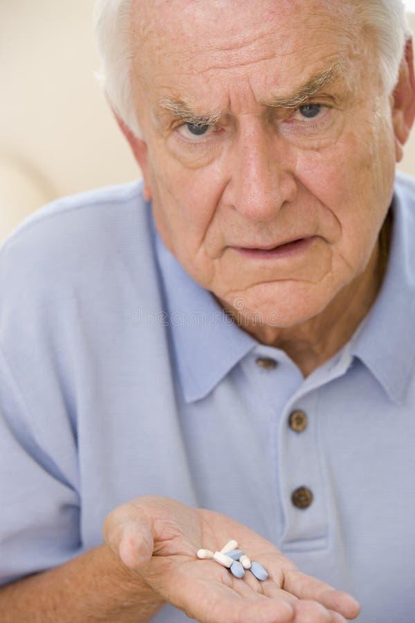 Senior Man Holding Prescription Drugs Royalty Free Stock Images