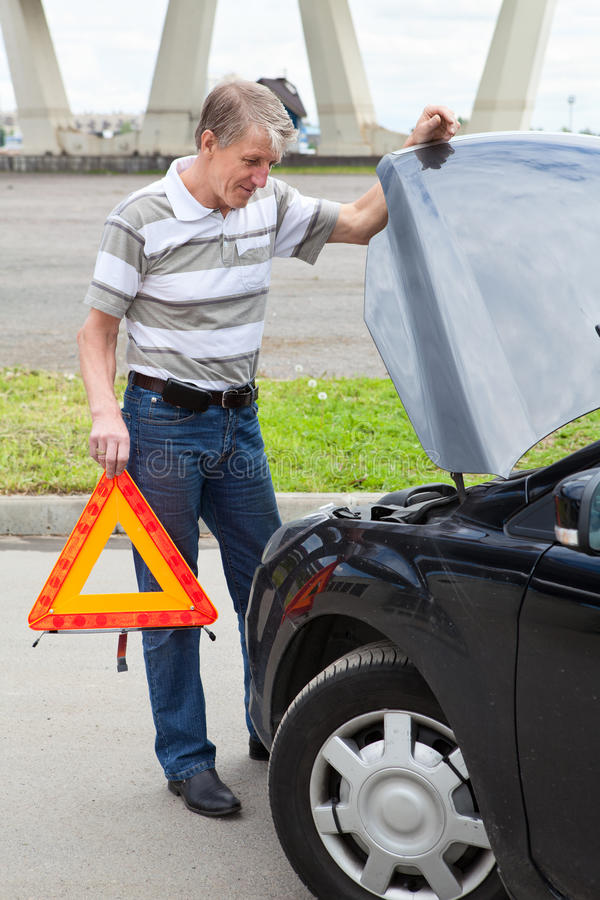 Download Senior Man Holding Warning Sign Near Car Stock Photo - Image of mature, assistance: 25638908