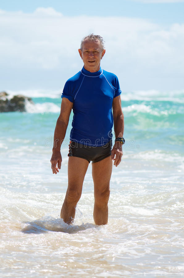 Download Senior man on holidays stock image. Image of swim, protection - 23182929