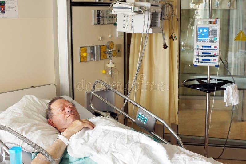 Senior man in hospital bed royalty free stock photo