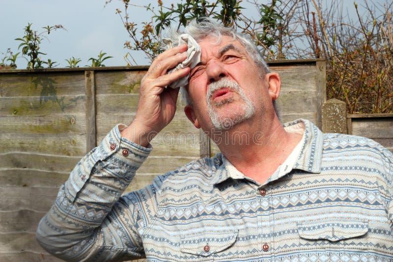 Senior man hot and sweating. royalty free stock photography