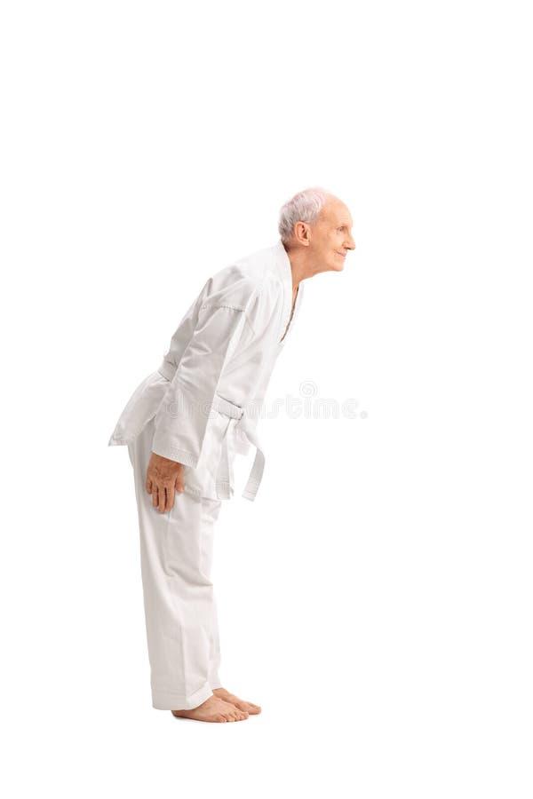 Free Senior Man In A White Kimono Bow Down Stock Images - 58887754